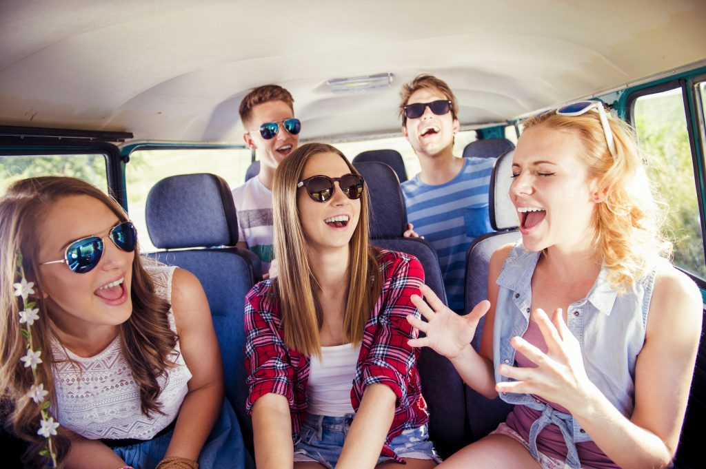 a group of friends laughing in the car
